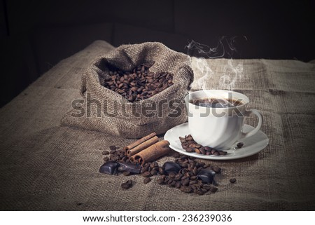 Coffee beans with coffee cup