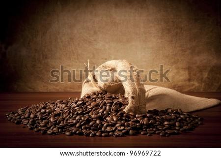 Coffee beans with juta bag - stock photo
