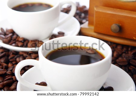 Coffee beans with white cups on the table