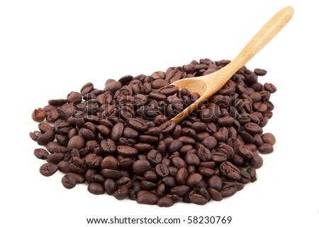 coffee beans with wood spoon isolated on white - stock photo