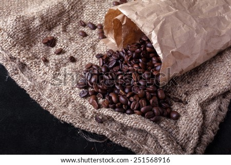 coffee beans woke up from paper package  - stock photo