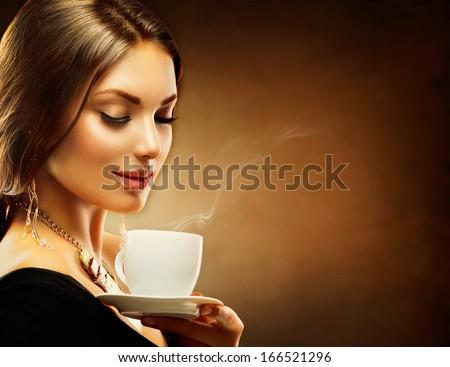 Coffee. Beautiful Girl Drinking Tea or Coffee. Beauty Woman enjoying Coffee. Cup of Hot Beverage. - stock photo
