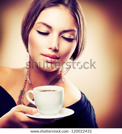 Coffee. Beautiful Girl Drinking Tea or Coffee. Cup of Hot Beverage.Sepia Toned - stock photo