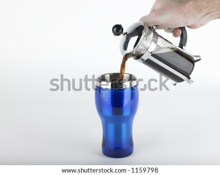 Coffee being poured from french press - stock photo