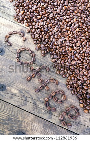 Coffee berries of the coffee spelled words. - stock photo
