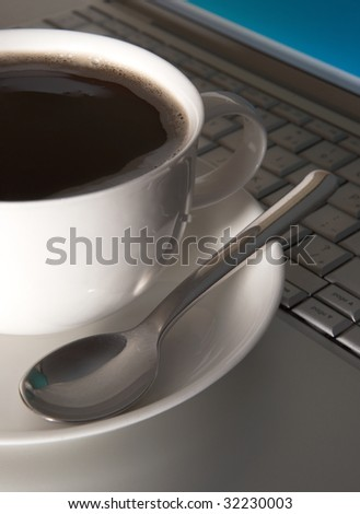 Coffee break from computer modern cup and laptop - stock photo