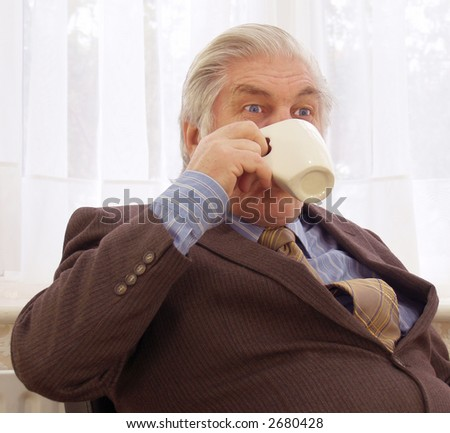 Coffee break time for old blue eyes - stock photo