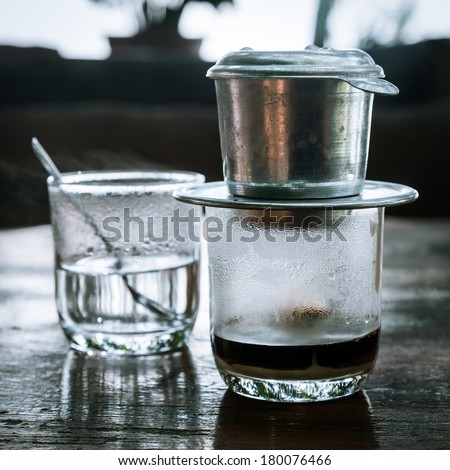 Coffee brewed in  traditional vietnamese style - stock photo