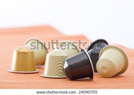 coffee capsules with different colors - stock photo