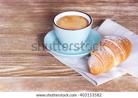 Coffee croissant on wooden table background empty copy space.French breakfast. - stock photo
