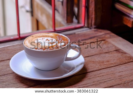 Coffee Cup and Beans / Coffee Cup / Coffee Cup and Beans on Wooden Table - stock photo
