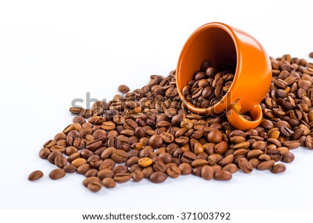 Coffee cup and beans on a white background. - stock photo