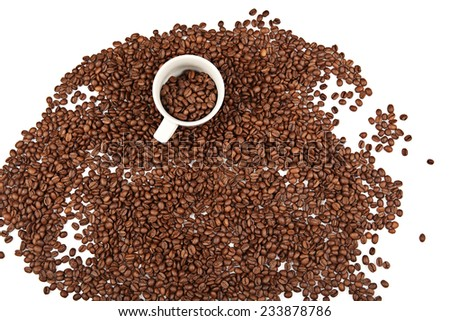 Coffee cup and beans on a white background. studio - stock photo
