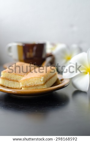 Coffee cup and bread on the wooden table