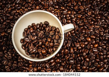 coffee cup and coffe beans - stock photo