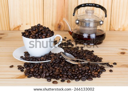 coffee cup and coffee beans - stock photo