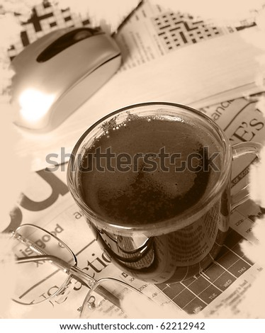Coffee cup and computer mouse with glasses on news - stock photo