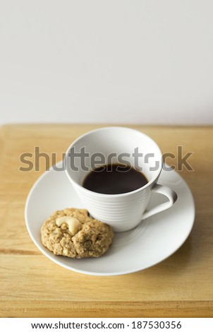 Coffee cup and cookies on wooden table background - stock photo
