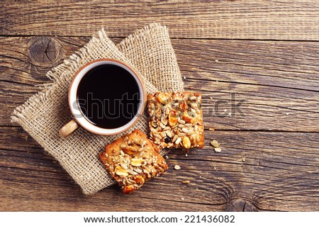 Coffee cup and cookies with nuts on vintage wooden table. Top view - stock photo