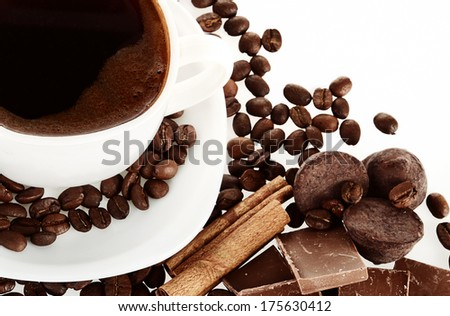 Coffee cup and grain with chocolate and cinnamon, isolated on white background
