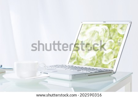 Coffee Cup And Laptop - stock photo