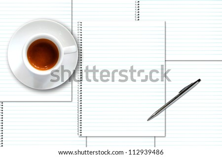 coffee cup and notebook with pen