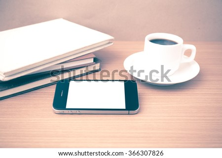 coffee cup and phone and stack of book on wood background vintage style