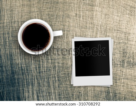 coffee cup and retro photo over grunge background