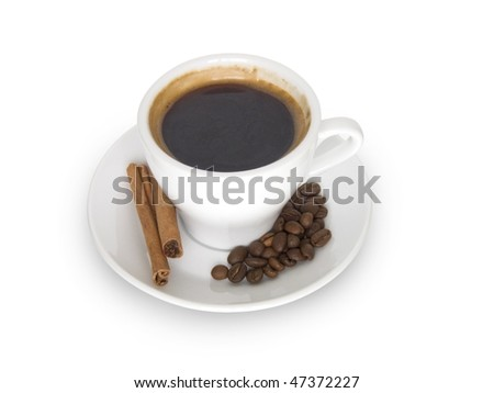 coffee cup and saucer, cinnamon and coffee beans