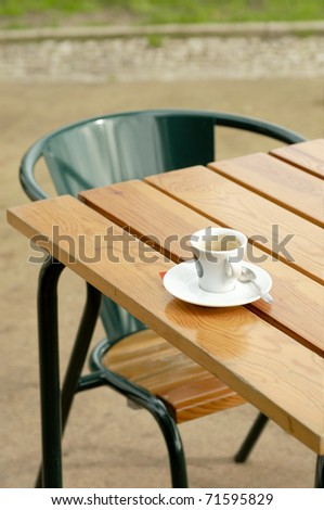 Coffee cup at table at cafe - stock photo