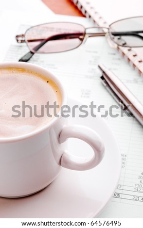Coffee cup,ballpoint pen,glasses and financial report - stock photo
