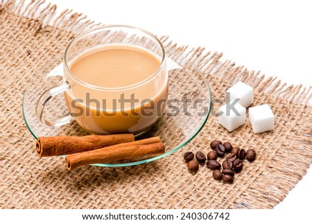 Coffee cup bean sugar cube Cinnamon on jute sack background - stock photo