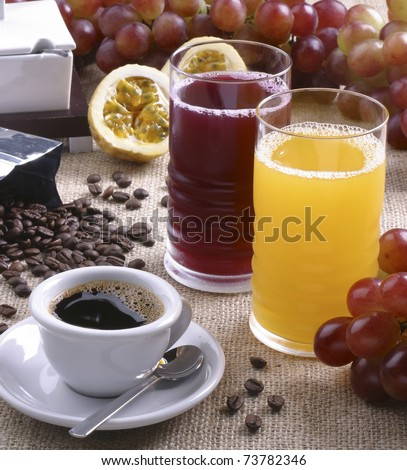 Coffee cup, grape and passion fruit juice in tall glasses - stock photo