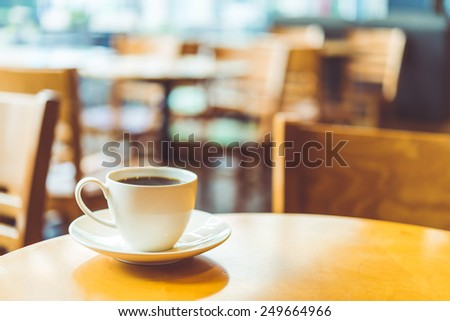 Coffee cup in cafe shop - vintage effect style pictures - stock photo