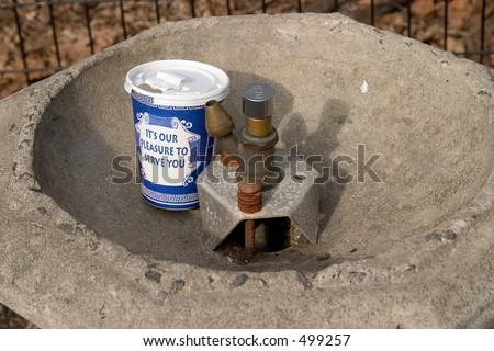 coffee cup in drinking fountain - stock photo
