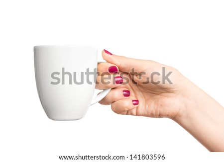 Coffee cup in hand - stock photo