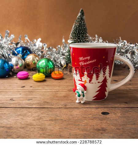coffee cup  ,macaroon with snow man, Christmas ball and tree, decorate on wooden background for Christmas holiday ,vintage color tone. - stock photo
