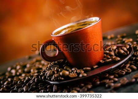 Coffee. Cup of black coffee and spilled coffee beans. Coffee break. - stock photo