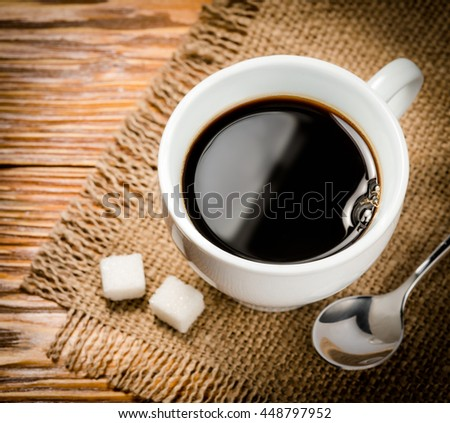 Coffee. Cup of coffee on wooden table