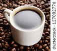 Coffee cup on a coffee grains background - stock photo