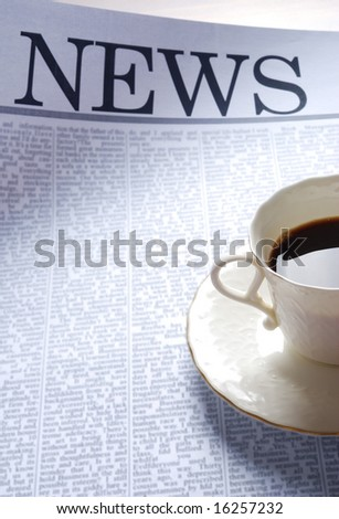 coffee cup on a newspaper page. office breakfast. - stock photo