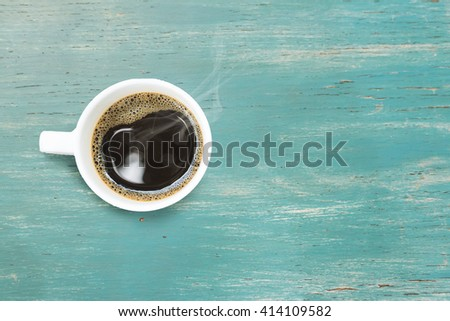 Coffee cup  on a wooden table and sack background,Vintage color tone - stock photo