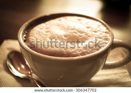 coffee cup on blur background in vintage color style on mulberry texture background