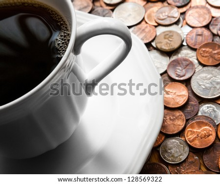 Coffee cup on coins. Quarters, pennies and nickels.  Financial concept - stock photo