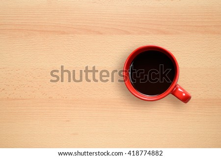 Coffee cup on desktop background - stock photo