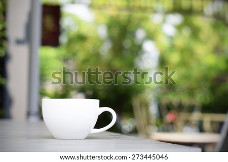 Coffee cup on table in garden