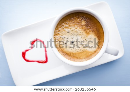 Coffee cup on the wooden table. - stock photo