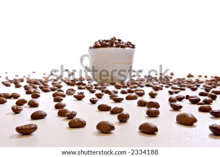 Coffee cup on with beans, on white background with deep perspective, focus on beans - stock photo