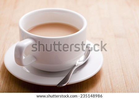 coffee cup on wooden board. - stock photo