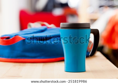 Coffee cup on wooden table. - stock photo